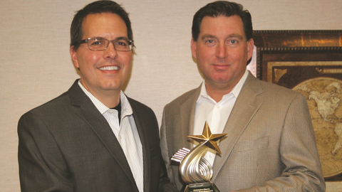 Bob Brown Jr., Great Lakes regional sales manager for Automotive Fleet (right), presents the...