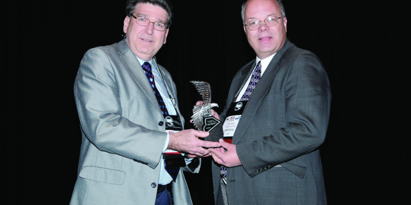 Automotive Fleet's Editor Mike Antich (right) gives Dan Kennedy (left) the award for the 2012...