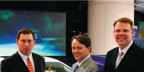 Brent Dewar (center), VP, Chevrolet Global Brand, and Jim Campbell (right), general manager, GM...