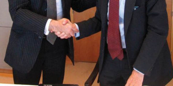 Gianluca Soma (left), CEO of ALD, and Jim Frank, CEO of Wheels Inc., celebrate their companies'...