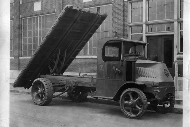 Prior to the development of hydraulics in the 1930s, upfitted trucks, such as the one above, used chain-driven mechanisms to get the job done.