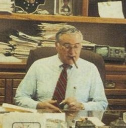 Ed Bobit, at his desk, 1990