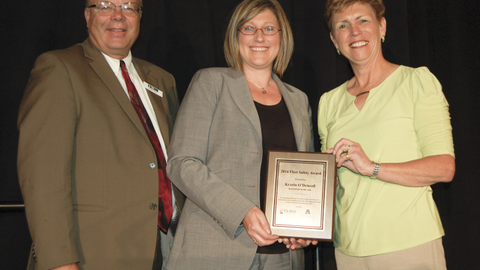 Editor Mike Antich and AALA Executive Director Pam Sederholm (right) flank Fleet Safety Award...