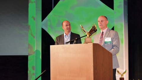 Dan Frank (left) presents the 2014 Professional Fleet Manager of the Year award to Gage Wagoner....