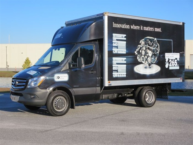 Van body has graphics advertising the new standard 2.1-liter I-4 diesel. Photo: Tom Berg