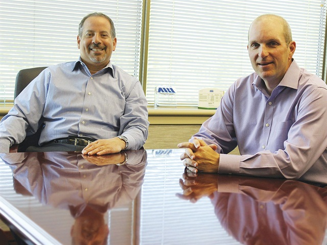 Carl Ortell (left) is the CEO of Holman Automotive Group. A 29-year employee of Holman, Ortell was previously the president of ARI, a position held since 2010. Chris Conroy (right) is the new executive vice president of Holman Automotive Group and president of ARI. Conroy joined ARI in 1994. Photo courtesy of ARI.