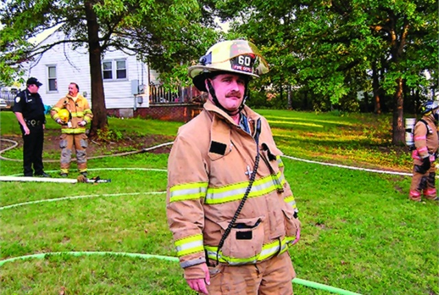 In his 20 years fighting fires and helping others in Mayodan, N.C., Bryant Garner (right) has held the positions of fire fighter, lieutenant, captain, and, since 2004, chief. By day, he is fleet and travel administrator for Merz North America, Inc.