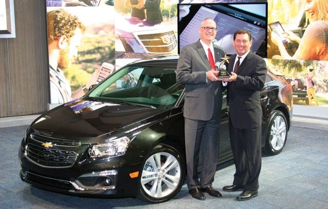 Bob Brown Jr., Great lakes sals manager for Automotive Fleet (right), presented the 2014 Fleet Car of the Year Award to Ed Peper, U.S. vice president for fleet and commercial sales for GM. This is the first time the Cruze has received the annual award.