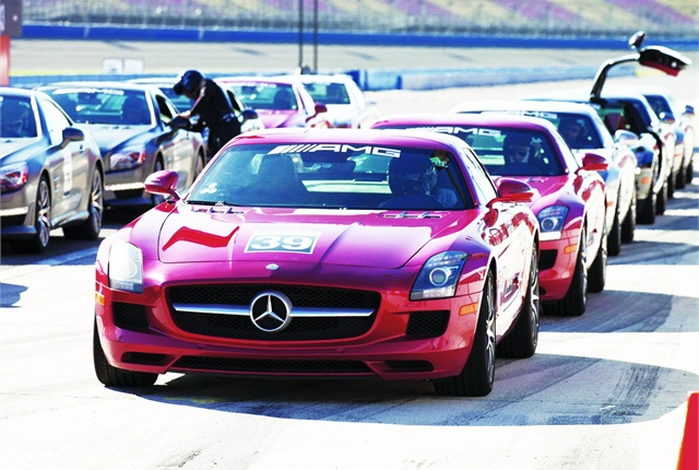 A line of SLS AMGs in the paddock await the go-ahead to conduct high-speed exercises on the oval track.