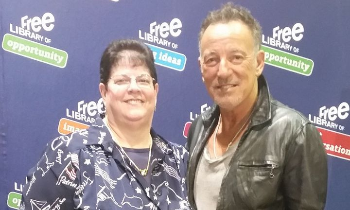 Debbie Ricciardelli, fleet analyst/procurement for Pearson Education, with Bruce Springsteen.