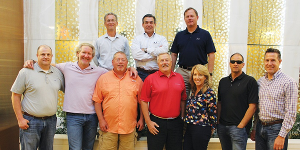 Don Borthwick (center ofrear row) leads a 10-person team that includes eight strategically...