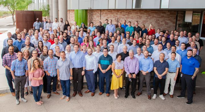 Gary Fitzgerald (sixth from left, first row) is leading GPS Insight through a branding update to better represent the company's strategic direction.