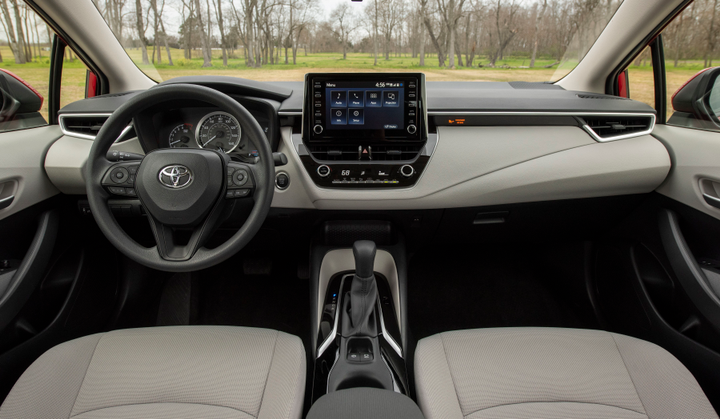 An 8-inch dashboard display is mounted in landscape orientation.