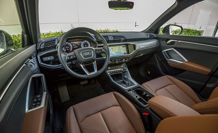 The cockpit is very driver-centric with interior controls angled toward the driver.