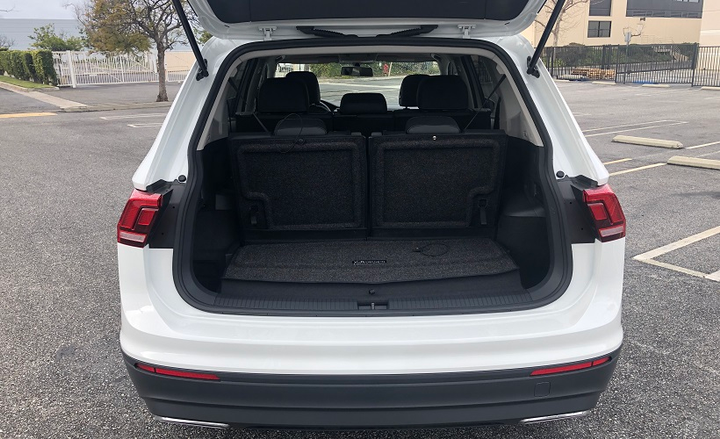 In three-row model we tested, folding the rear seats created 33 cubic feet of rear cargo space, and that could be expanded to a maximum of 65.7 cubic feet by folding the second row using the levers in the cargo area.
