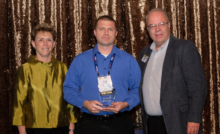 Blair Schober (center), fleet, EH&S, and telecom manager for Red Hawk Fire & Security was named winner of the 2018 Fleet Safety award during the Fleet Safety Conference today. From left to right are Pam Sederholm, executive director of AALA; Schober; and Mike Antich, editor of Automotive Fleet.