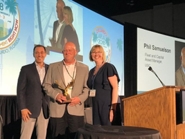 Phil Samuelson (center) accepts the Edward J. Bobit Professional Fleet Manager of the Year award...
