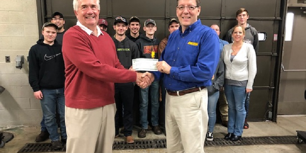 John Dmochowsky (left), winner of the 2017 Fleet Manager of the Year award, handed a $5,000...