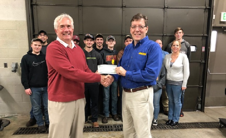 John Dmochowsky (left), winner of the 2017 Fleet Manager of the Year award, handed a $5,000 scholarship check to Gary Maike (r), associate professor at Ferris State University.
