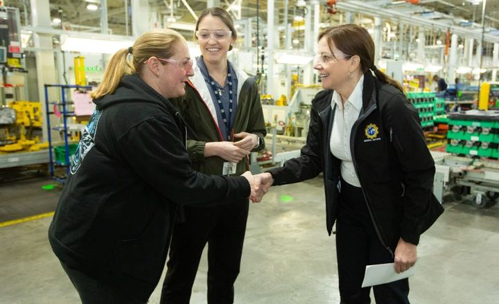 GM's CEO Mary Barra greets a worker at Romulus propulsion plant.