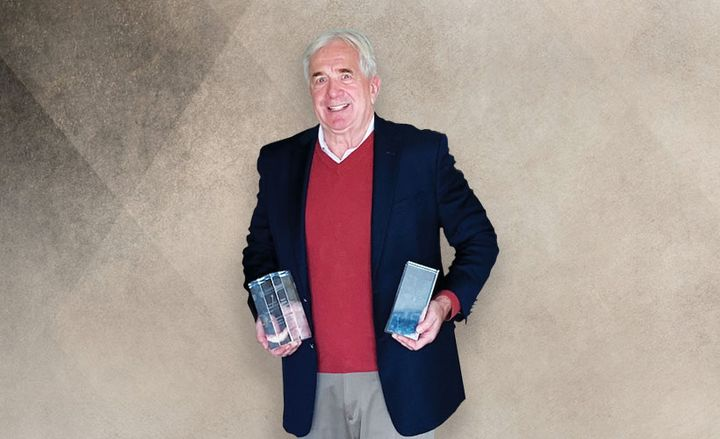 Dmochowsky holds the two awards he took home from the Fleet Europe Summit. - Photo courtesy of John Dmochowsky