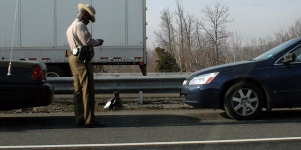 Minnesota's hands-free law, which bans drivers from holding a cellphone or other wireless...