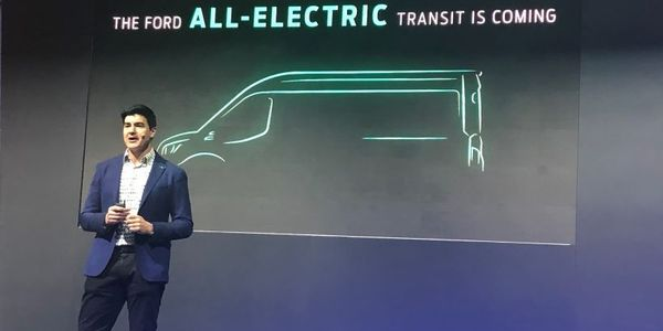 Ted Cannis, global director for electrification for Ford, announces the all-electric Transit at...