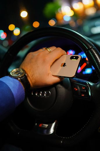The national survey of more than 1,000 motorists reveals that people can't seem to keep their hands off their phones — especially since COVID-19 hit. - Photo viaUnspalsh/Dmitry Vechorko.