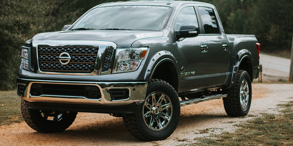 The Nissan Titan Rocky Ridge Altitude Package offers 6.0-inch suspension, 2.0 Nitrogen Charged...