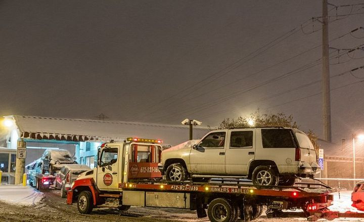 Impound fees now exceed $1.1 billion, according to a new report from telematics provider Spireon.  - Photo via Snow Emergency Tow Trucks/Wikimedia.