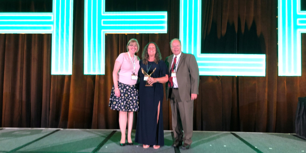 Erin Gilchrist (middle) of Safelite AutoGlass accepted the 2019 Edward J. Bobit Professional...