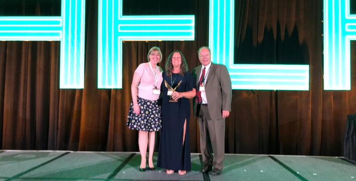 Erin Gilchrist (middle) of Safelite AutoGlass accepted the 2019Edward J. Bobit Professional Fleet Manager of the Year; Wheels' Laura Jozwiak (left) and Automotive Fleet's Mike Antich (r) presented the award to her.  - Photo by Andy Lundin.