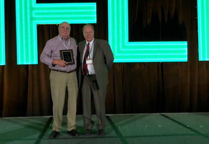 Jim Christiano (left) accepted Bud Morrison's award from Automotive Fleet's Mike Antich (right). 