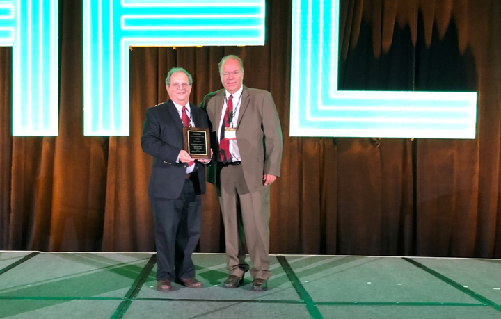 Joe LaRosa (left) accepted the plaque representing his induction into the 2019 Fleet Hall of Fame from Automotive Fleet's Mike Antich (right). 