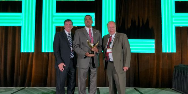 Kenneth Jack (center), VP - fleet operations for Verizon Communications, received the 2020 Fleet...