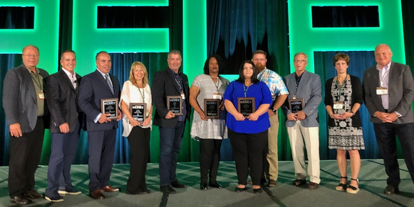 Fleet Visionary recipients accepting their awards at the AFLA 2019 conference are flanked by...