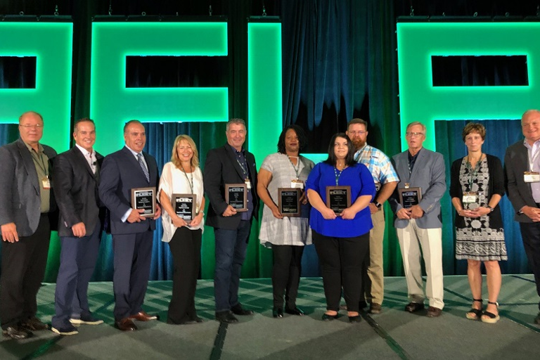 Fleet Visionary recipients acceptingtheir awards at the AFLA 2019conference are flanked by...