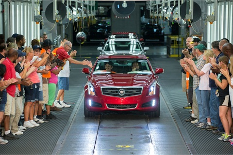 The 2013 Cadillac ATS rolls off the assembly line at GM's Lansing Grand River plant.
