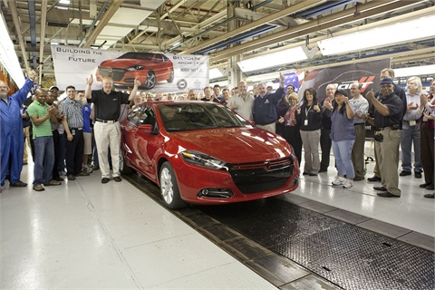Belvidere Assembly Plant Manager Kurt Kavajecz (left), UAW Local 1761 President Bob Cunningham and UAW Local 1268 President George Welitschinsky celebrate with employees as the first Dodge Dart rolls off the assembly line.