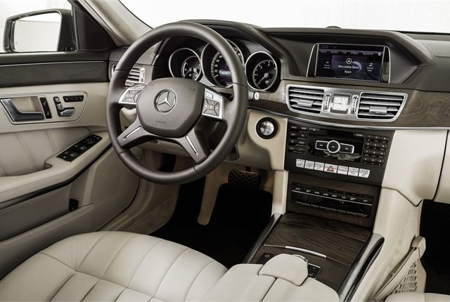 The E-Class' interior features a two-part trim piece that extends across the dashboard.