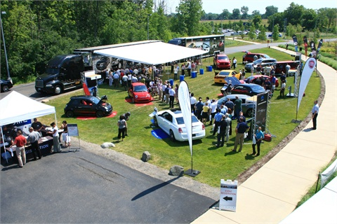 Employees from Robert Bosch Corp. check out Chrysler products during the road tour.