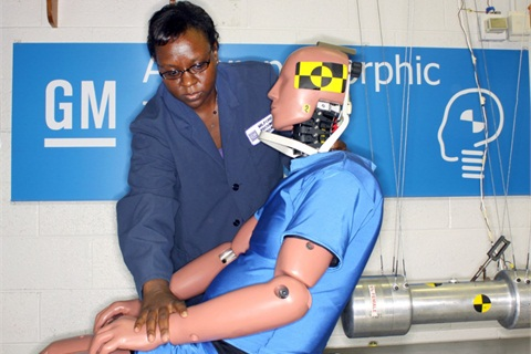 Engineer Barbara Bunn works with a BioRID crash test dummy in the GM Anthropomorphic Test Lab at the Milford Proving Ground in Milford, Mich. (Photo by Chris Guddeck for General Motors).