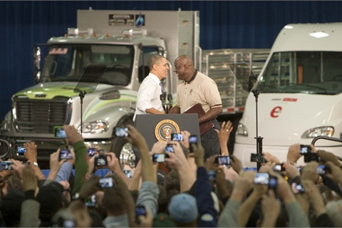 At 32 years with the Company, Juan Smith (right), Engine Quality Assurance Specialist for the Daimler Trucks North America (DTNA) Manufacturing Plant in Mount Holly, welcomes President Barack Obama (left) at DTNA. Photo courtesy Daimler Trucks North America.