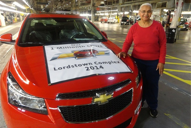 Lordstown's longest-tenured female employee poses with the 1 millionth Cruze. Photo courtesy of GM.