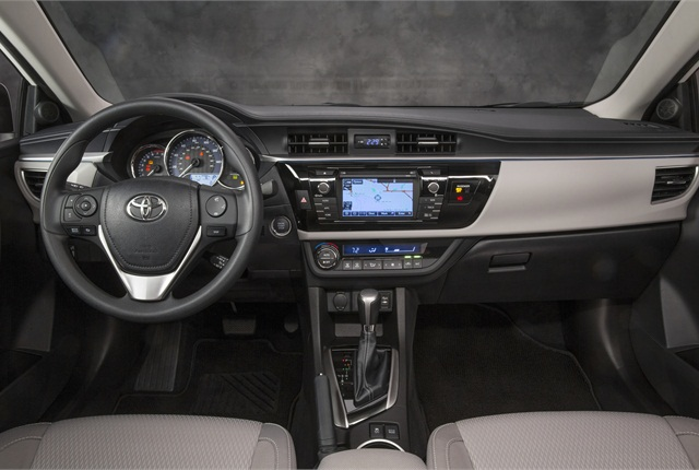 The instrument cluster and surrounding surfaces of the 2014 Toyota Corolla are piano black.