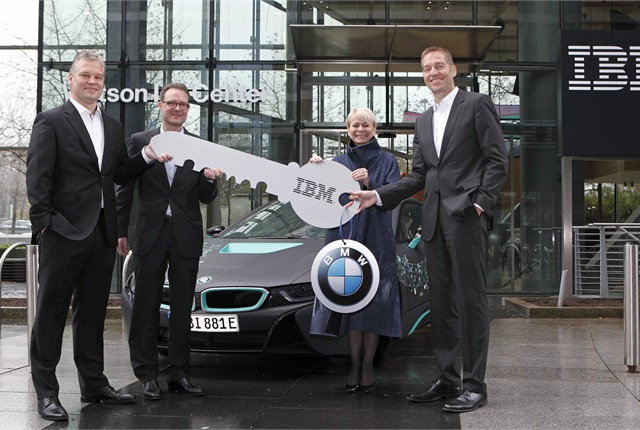 <p><em>BMW and IBM executives celebrate their companies' new collaboration at the Watson IoT headquarters in Munich, Germany. IBM's Harriet Green and Niklaus Waser present a symbolic key to BMW's Marcus Raisch and Alexander Kraubitz. Photo courtesy of IBM.</em></p>