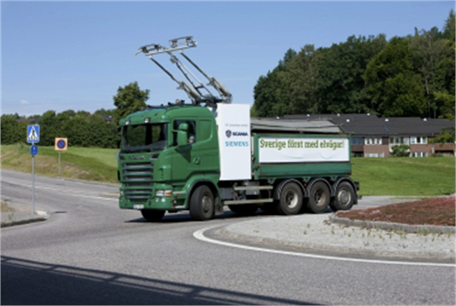 Scania truck with a pantograph on the roof.