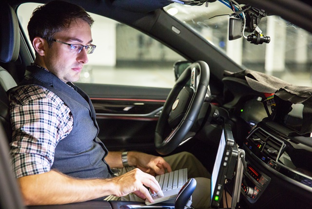 Photo ofBMW engineer André Mueller testing autonomous driving technology courtesy of Intel.