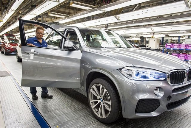 The new BMW X5 is inspected by Carolyn Tate at the automaker's Spartanburg, S.C. facility. Photo courtesy BMW.