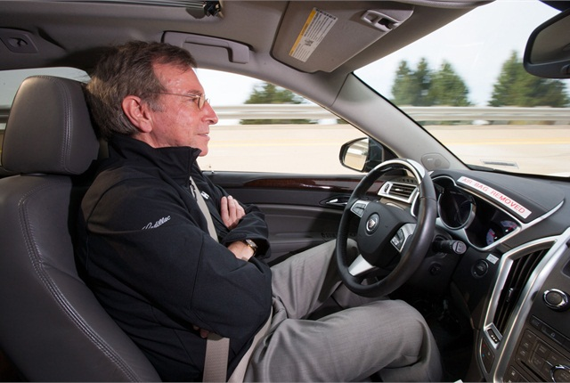 Jeremy Salinger, General Motors R&D manager for Super Cruise, demonstrates semi-automated driving technology that the automaker said could be available on Cadillac models later this decade. Photo courtesy GM.